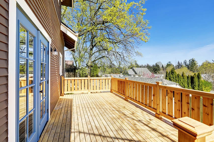 Backyard cedar deck on shingle house