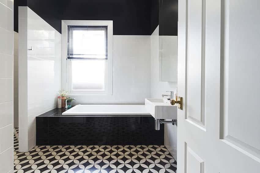 Bathroom with black and white vinyl flooring alcove tub