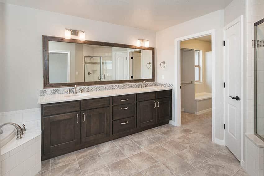 Bathroom with dual vanities and beige vinyl floor sheets