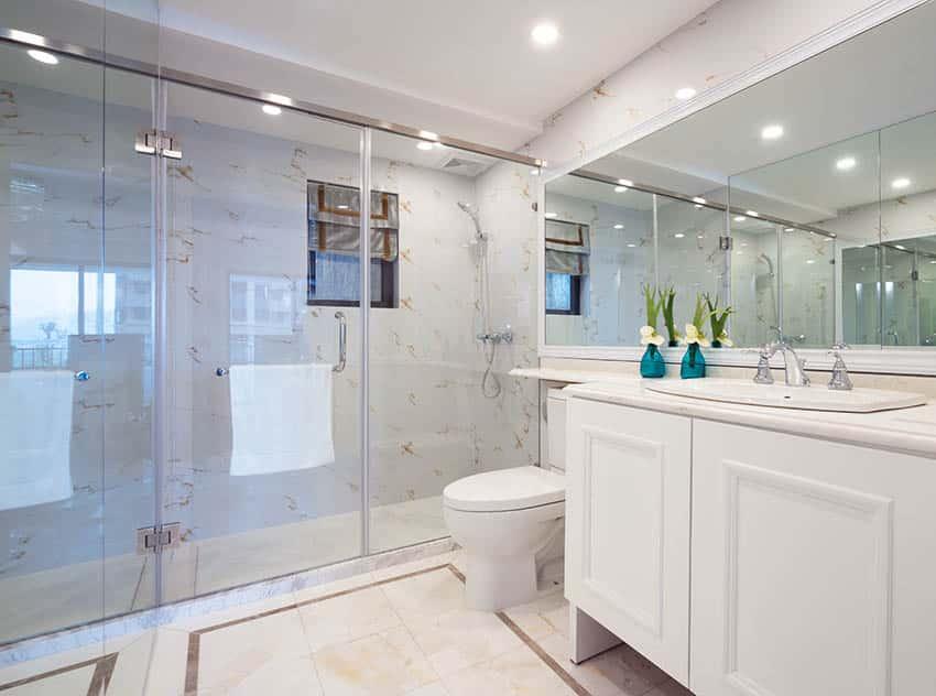 Bathroom with quartz shower walls white vanity