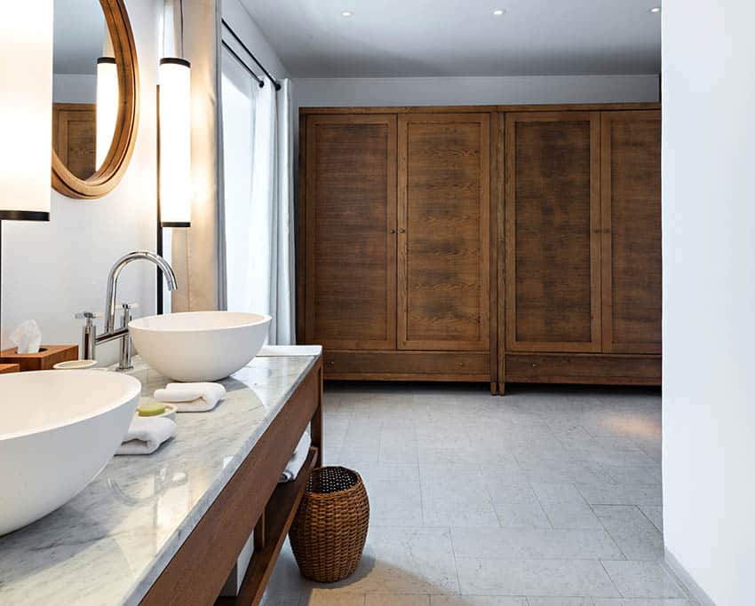 Bathroom with vessel sinks curved faucet