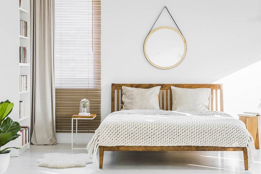 Bedroom with neutral color tan blinds