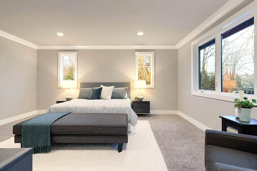Bedroom with same color gray paint for walls and ceiling