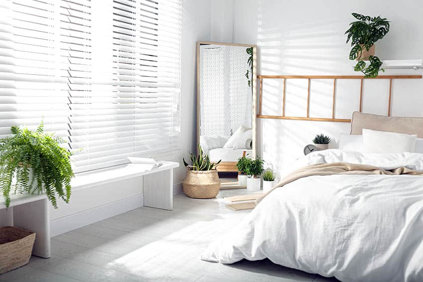 Bedroom with white on white color scheme blinds
