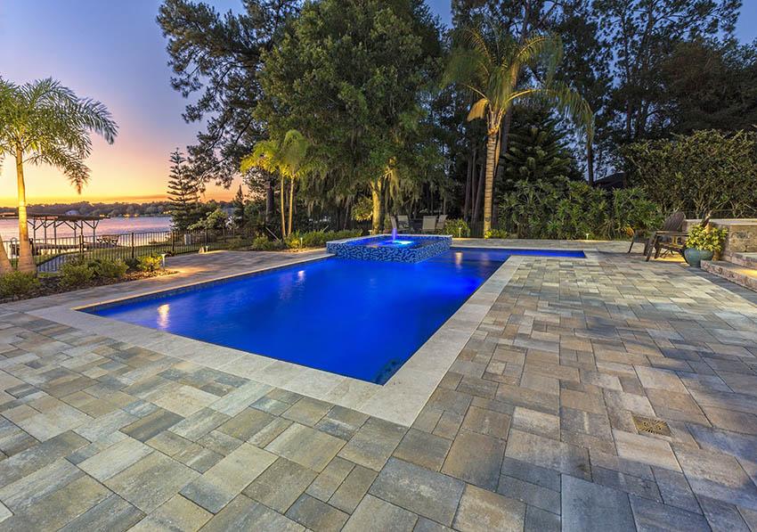 Bluestone patio design around swimming pool