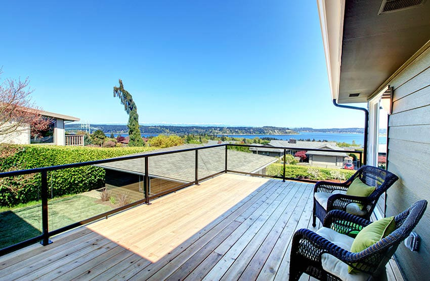 Cedar deck with metal railing with glass