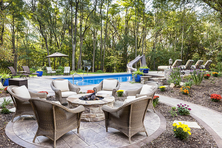 Circular stamped concrete patio with walkway and pool deck