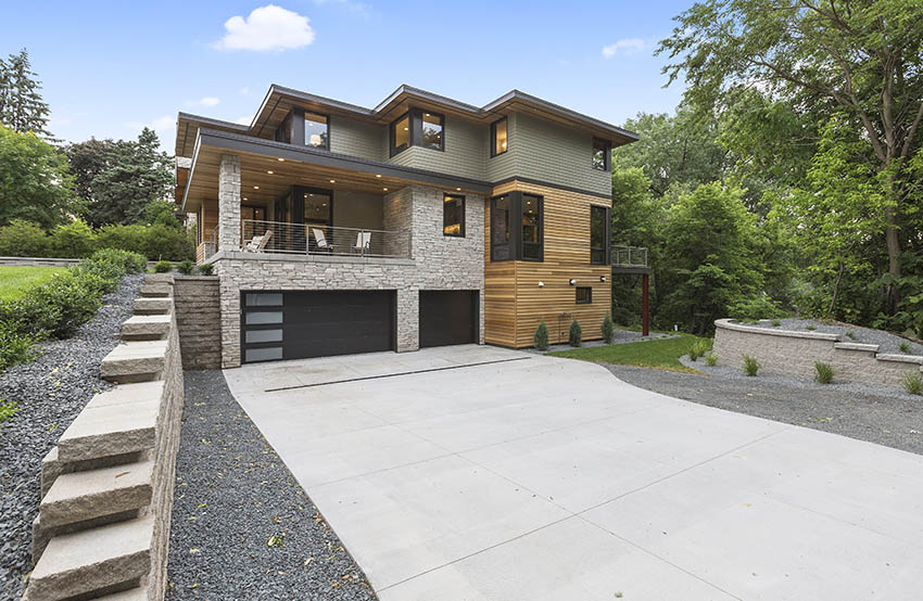 Contemporary house with concrete driveway gravel border