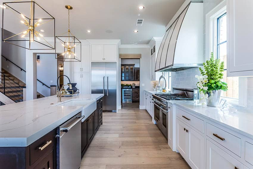 Contemporary kitchen with quartz countertops dark wood island white shaker cabinets