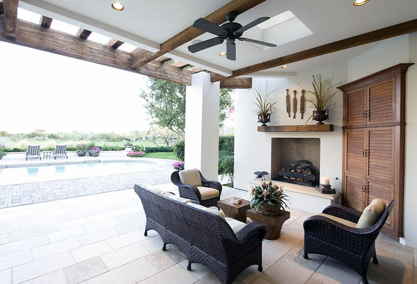 Covered travertine patio with fireplace