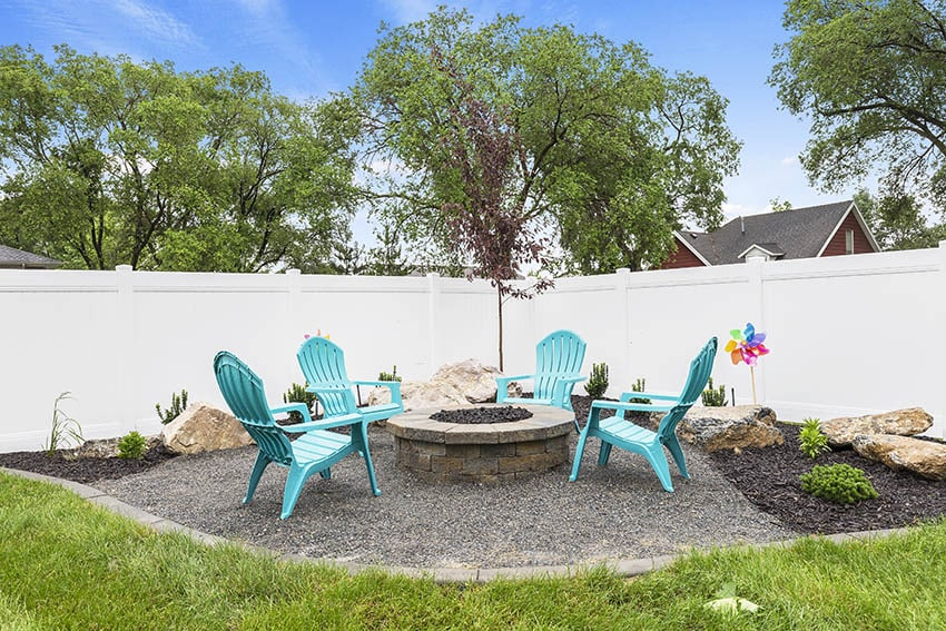 Gravel patio with teal polypropylene outdoor furniture