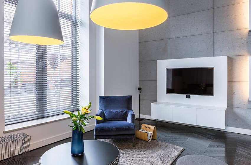 Industrial living room with grey wall window blinds