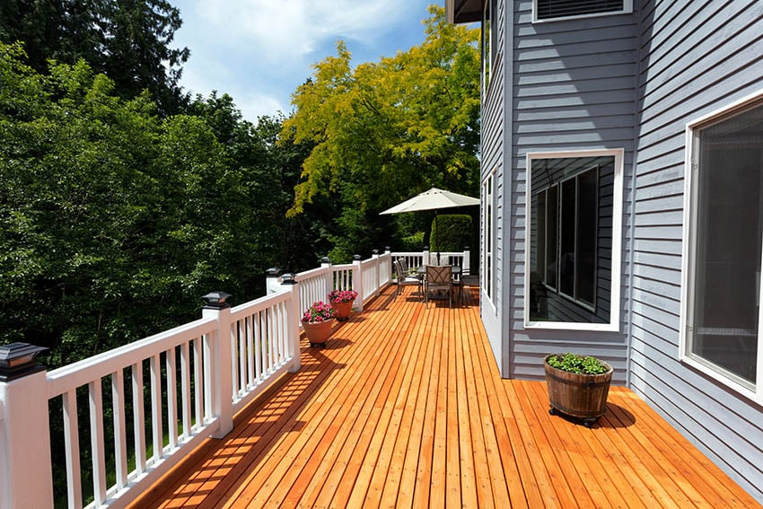 Large red cedar deck with white railing
