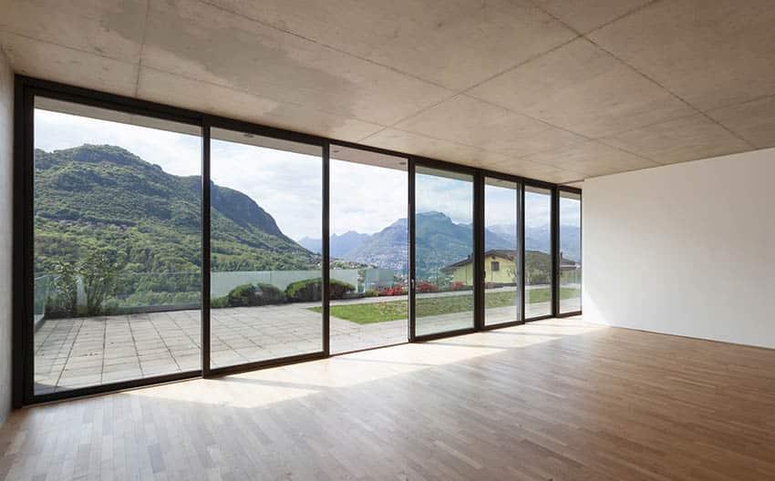 Large living room with black frame sliding doors