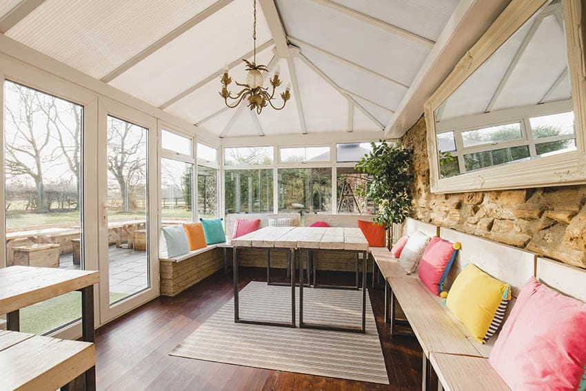 Large patio enclosure with bench seating chandelier