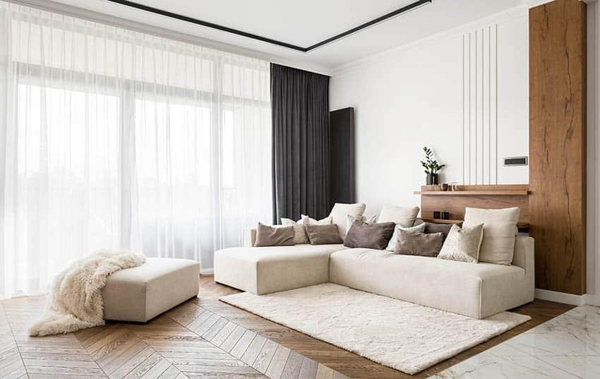 Living room with corner sofa and ottoman