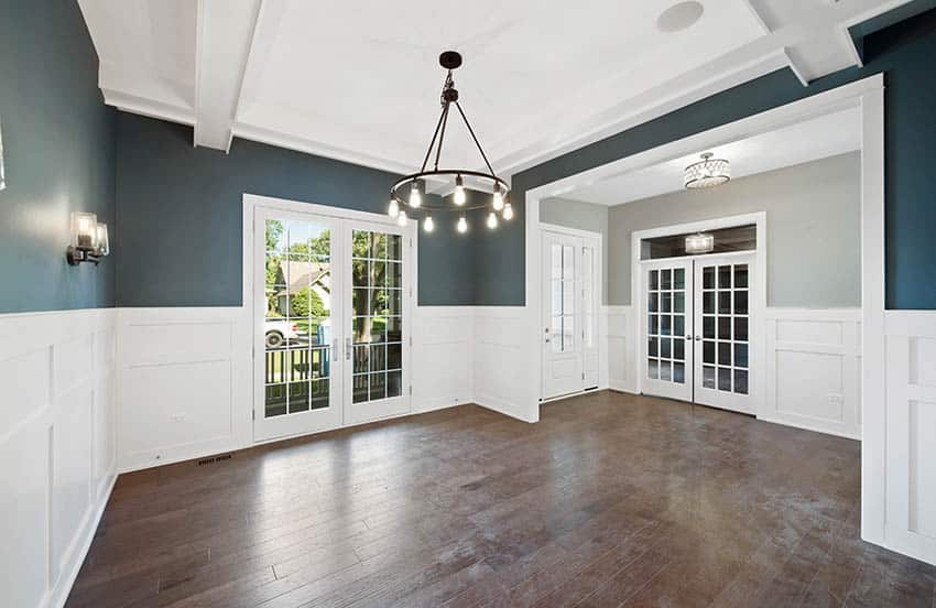 Living room with exterior and interior french doors