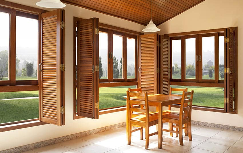 Louver plantation shutters with dining table