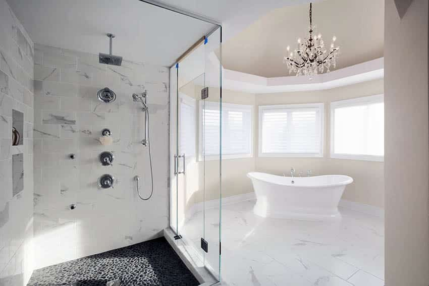 Luxury bathroom with rainfall shower head freestanding tub