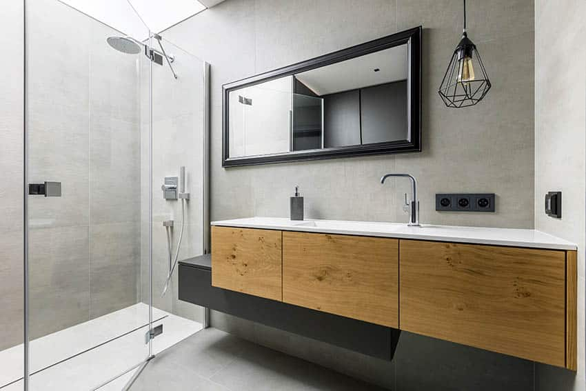 Modern bathroom with rain shower glass enclosure floating wood vanity