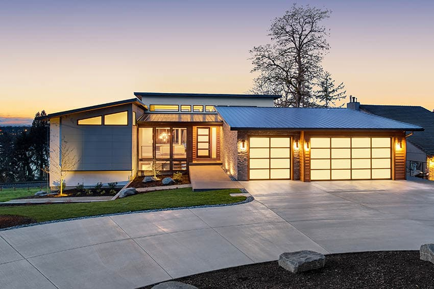 Modern home with curved concrete driveway