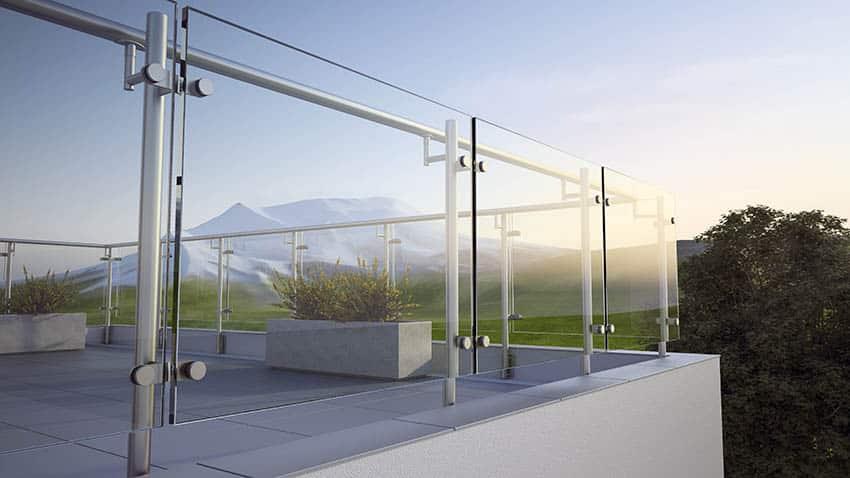 Modern raised concrete patio with glass railing concrete planter boxes