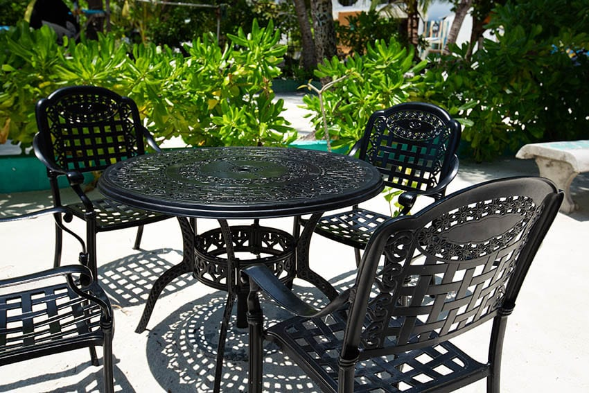 Outdoor patio with black ecoating steel dining table chairs