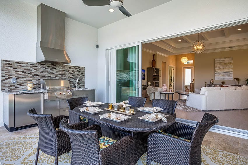 Outdoor patio with resin wicker dining set outdoor kitchen