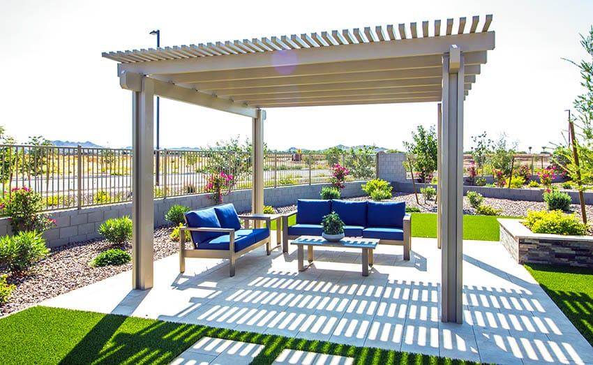 Patio with recycled plastic patio furniture under pergola