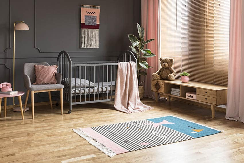 Pink blinds and curtains in baby nursery