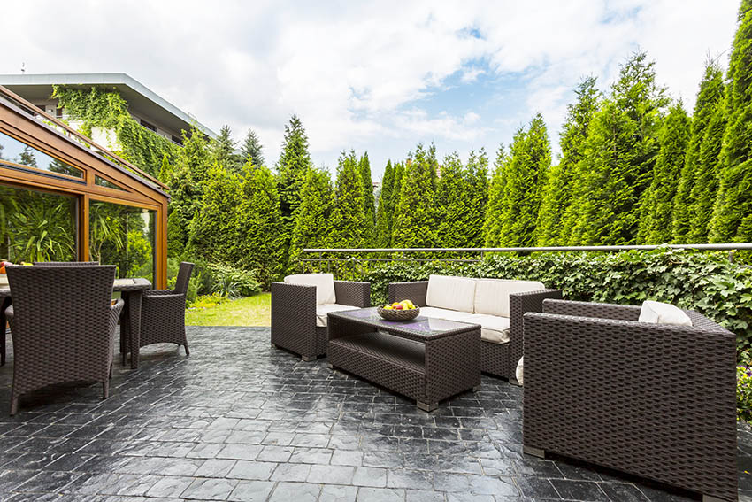 Raised black slate patio design with outdoor furniture