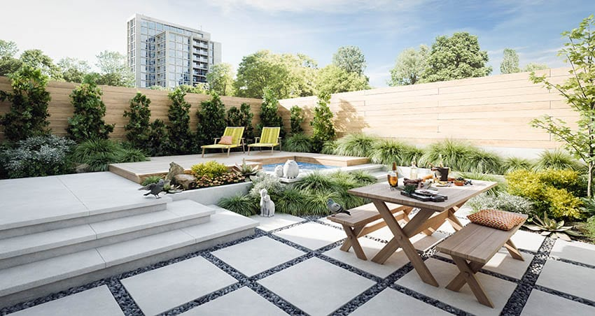 raised-concrete-patio-design-with-elevated-wood-deck-above-splash-pool-and-garden