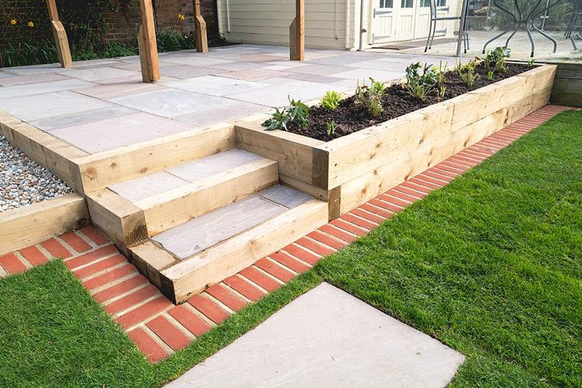 raised-concrete-patio-with-wood-planter-boxes-