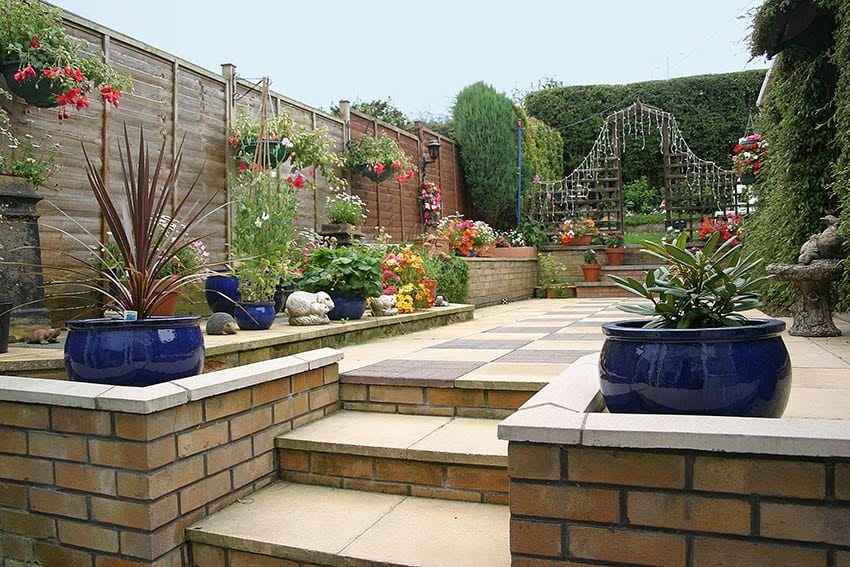 raised-paver-patio-with-planter-boxes-and-lattice-fence