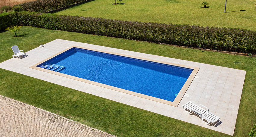 Rectangular swimming pool with concrete sun deck