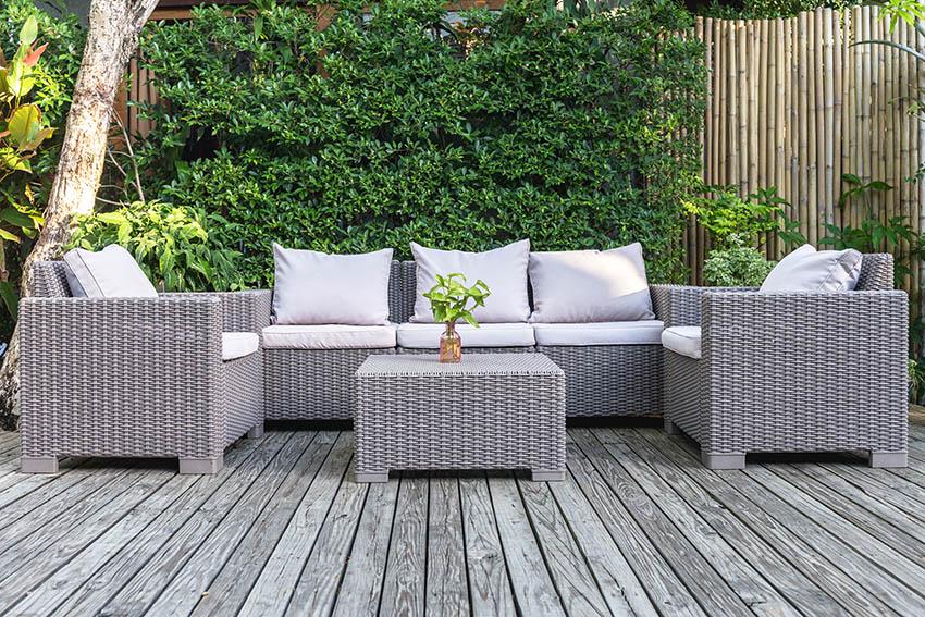 Resin wicker outdoor furniture on wood deck