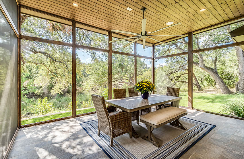 Screened patio enclosure with wood ceiling wicker furniture