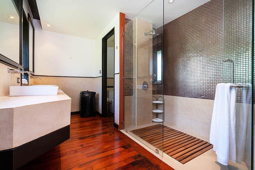 Shower with teak wood floors