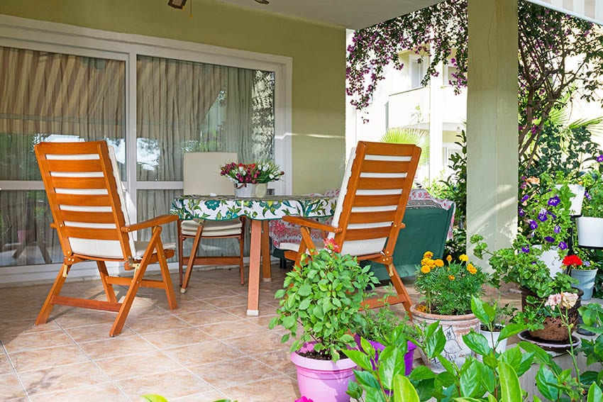 Teak wood garden table and chairs on outdoor patio