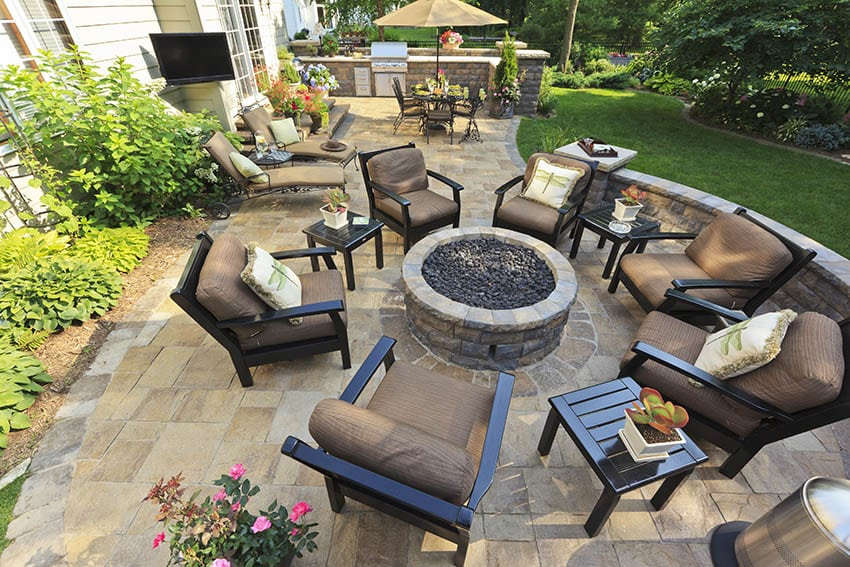 Travertine patio with fire pit outdoor tv