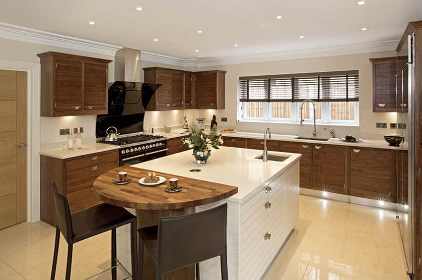 U shaped kitchen with brown window blinds cabinets center island with round butcher block countertop