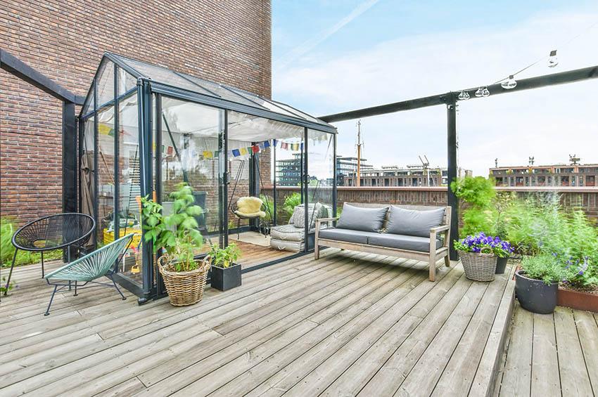 Vinyl patio enclosure on rooftop deck