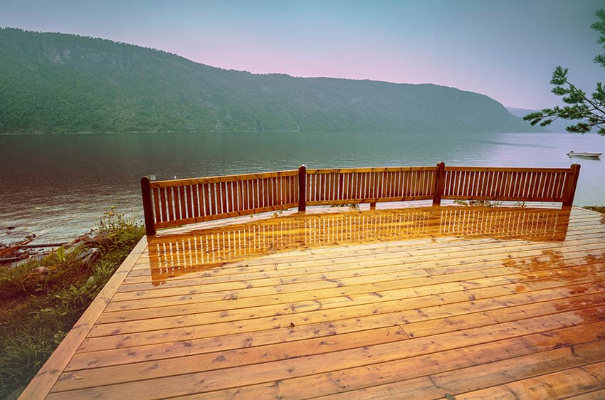 Waterfront cedar deck with wood railing