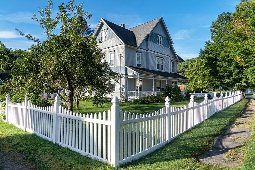 White picket fence around Victorian style house