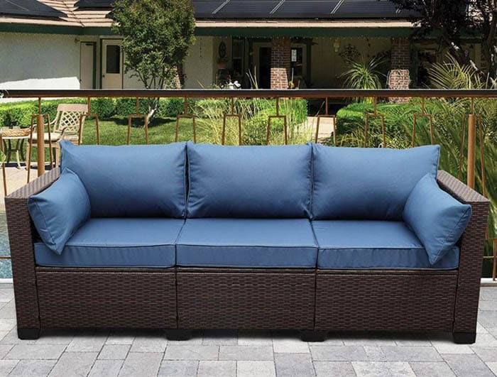 Wicker outdoor sofa with blue cushions