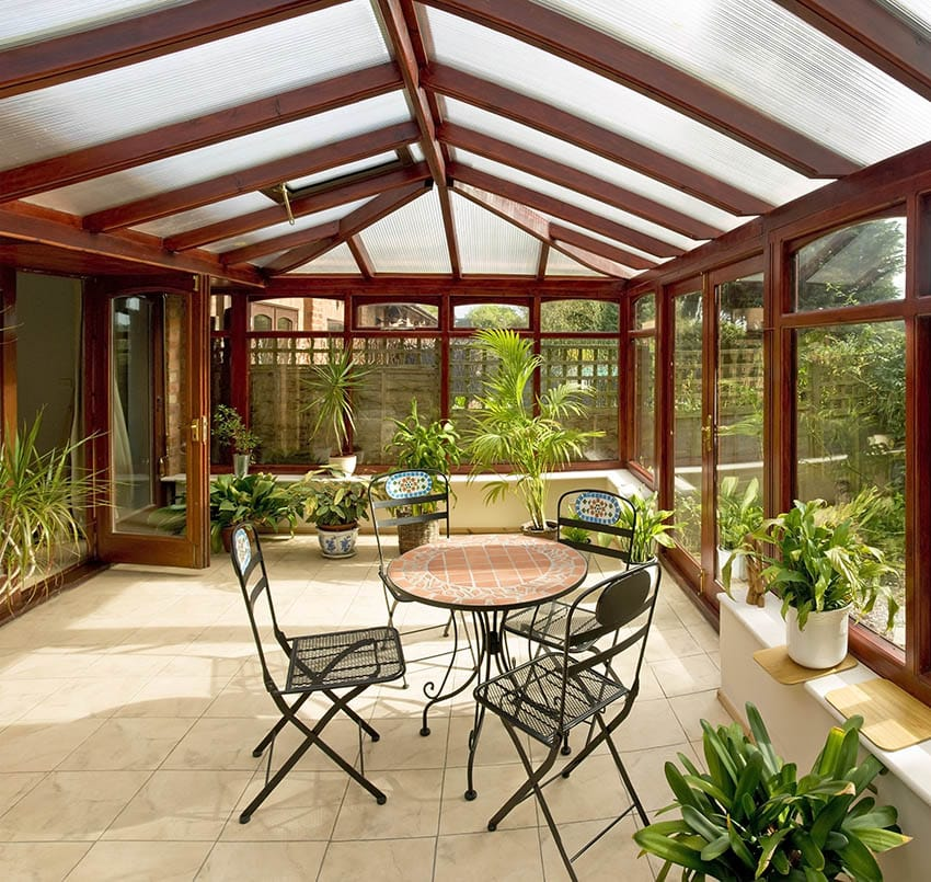 Wood and glass patio enclosure with arched ceiling acrylic roof panels