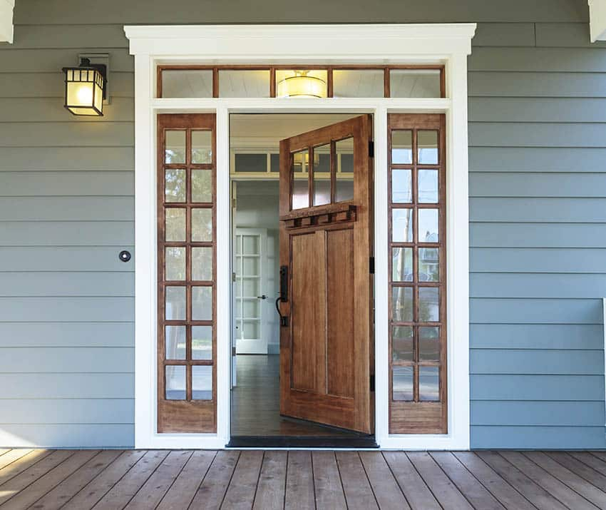 Wood door with white brickmold and sidelight windows