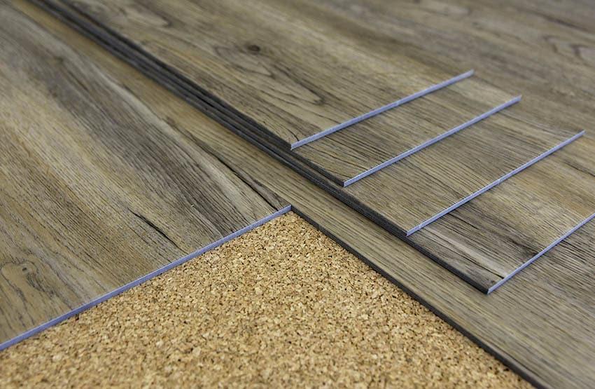 Wood look vinyl plank flooring on cork installation