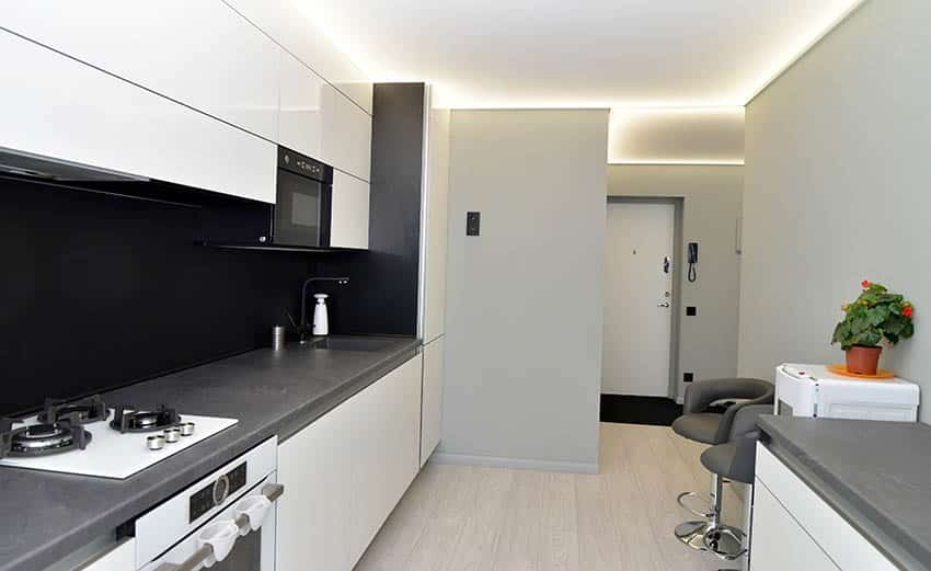 Apartment with galley kitchen gray laminate countertops