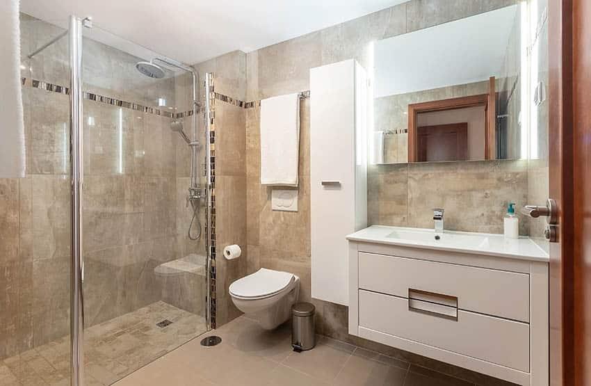 Bathroom with beige cultured marble shower surround walls